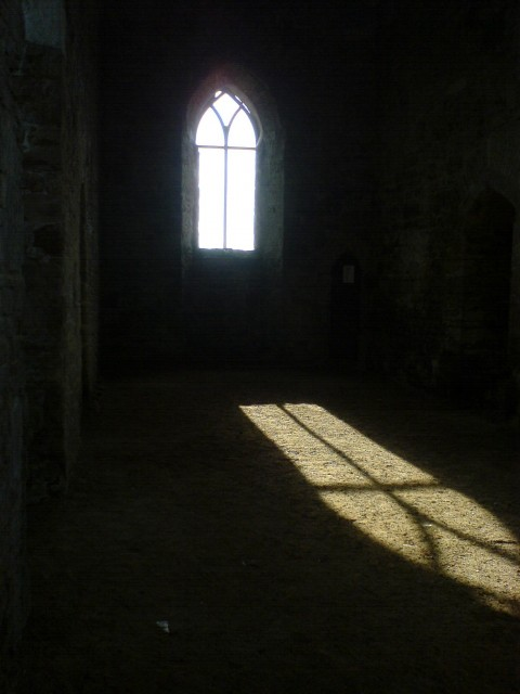 St Catherine's Chapel, near Abbotsbury, inside showing shaft of light shining onto and warming the earth inside