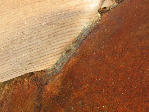 Close up of deep red rust on pipe surface