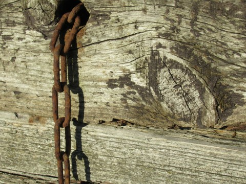 Corroded chain against timbers