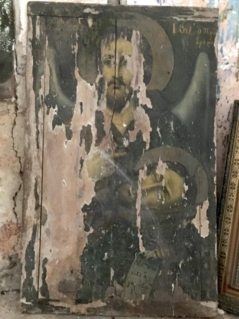 Close up of worn and faded icon in abandoned monastery